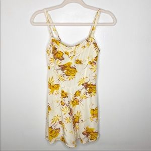 Free people ivory and yellow floral romper size 6